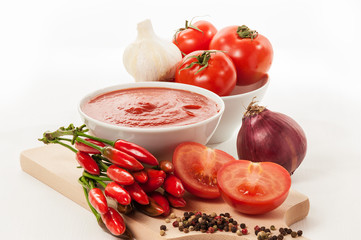Tomatoes in white cup - Stock Image