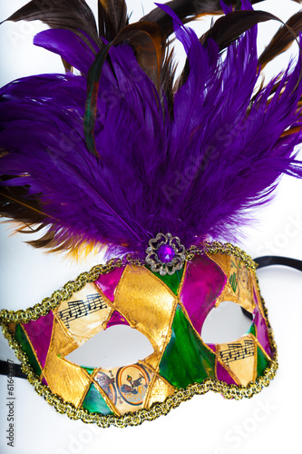 A colorful mardi gras or venetian mask on a white background