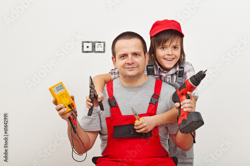 Working with dad - happy boy helping his father