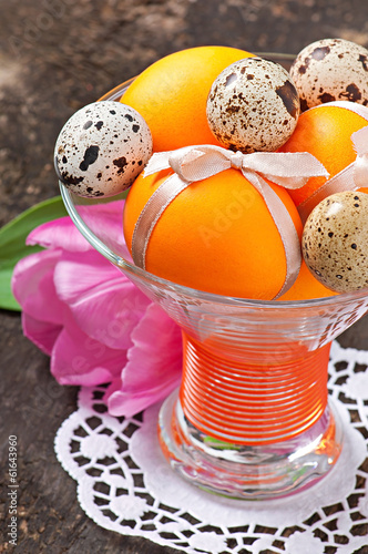 Colorful easter eggs on old wooden background