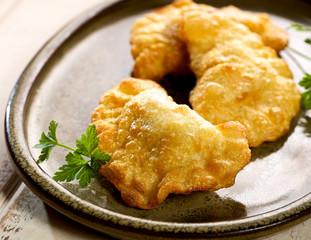 Dumplings fried in deep fat