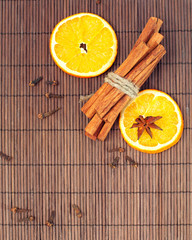 dry orange and spices on bamboo background