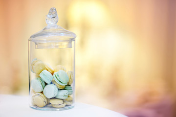 Traditional macarons in a glass jar