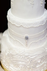 White wedding cake decorated with icing