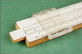 slide rule on a green background