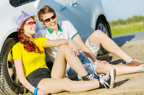 Couple near car