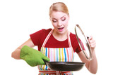 Happy housewife or chef in kitchen apron with skillet frying pan