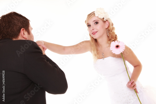Wedding day. Male groom kissing hand of female bride.