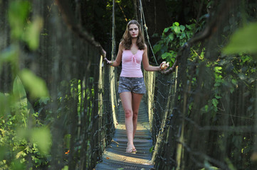 Sexy Adventurer on a Bridge.