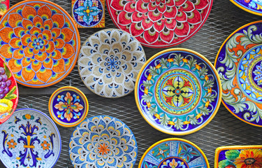 typical colorful ceramic dishes, tuscany, italy