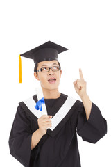 graduation student thinking some ideas and holding diploma