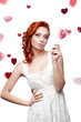 surprised red-haired woman holding lollipop