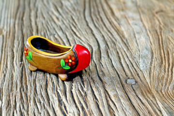 Traditional Turkish Single Clog With Wooden Table Backround