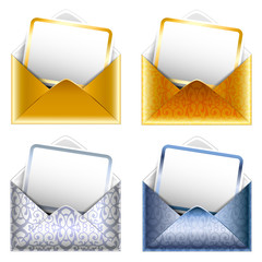 Set of patterned silver and golden paper envelopes with a postca