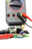multimeter and electronic spare components isolated on white bac poster