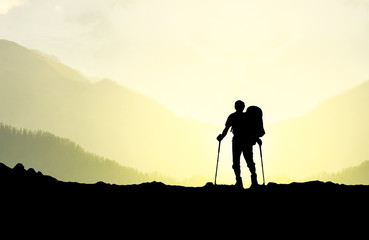 Silhouette of tourist in mountains. Sport and active life