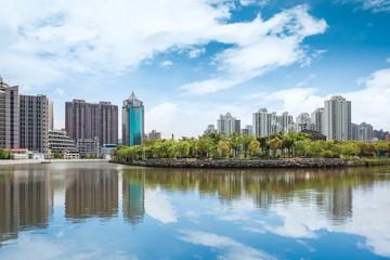 beautiful riverside city against a blue sky