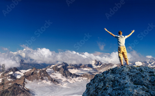 Tourist in mountains. Sport and active life concept