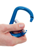 Male hand holding climbing carabiner
