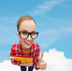student in glasses with folders showing thumbs up