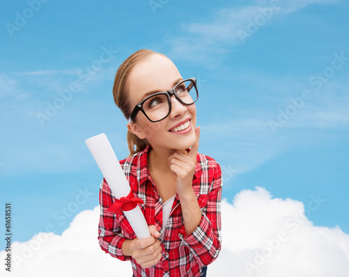 smiling woman in black eyeglasses with diploma