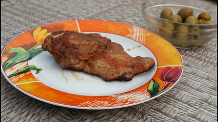 A sliced fried fillet steak with dressing