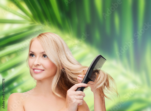 smiling woman with hair brush