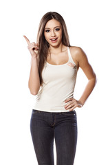 smiling young girl posing with a index finger up on white