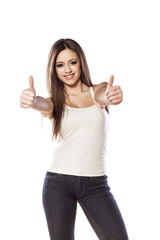 smiling young girl posing with a thumbs up on white background
