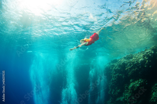 girl and corals in the sea