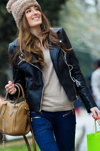 Young woman goes shopping in the city