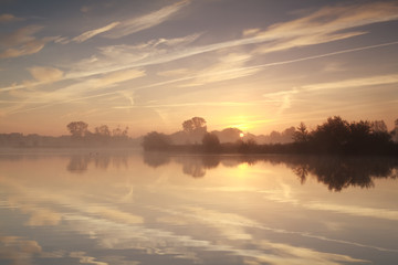 misty sunrise over river