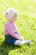 portrait of toddler girl sitting on lawn