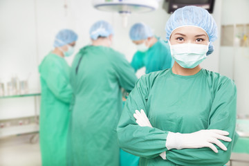 confident female surgeons  crossed hands with  teams