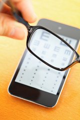 Eyechart on mobile screen with eyewear