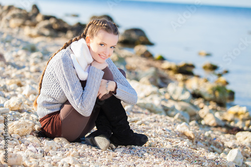 portrait of the young beautiful woman on the beach