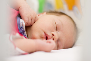 Peaceful newborn baby sleeping