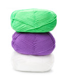 stack of yarn skeins in green, purple, white colors on white bac