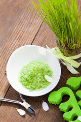 Green bath salt and pedicure tools