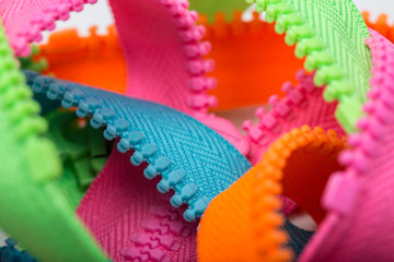 unsorted colorful zippers