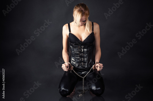 obedient slave woman in handcuffs