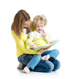 young mom reading a book to her kid