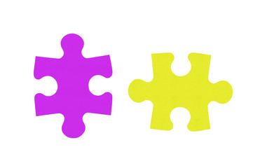 Colorful puzzles closeup isolated on white background