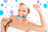Young cute woman holding toothbrush with teeth.