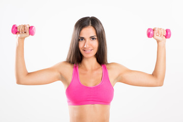 Young beautiful woman exercising with dumbbells.