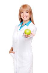 Smiling dentist holding green apple