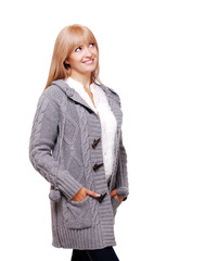 Happy young woman in a knitted cardigan