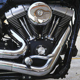Motorcycle engine head with exhaust pipe