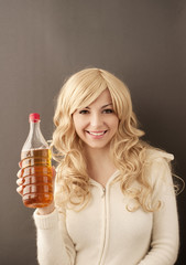 Girl holding apple cider vinegar