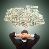 Businessman dreaming about money cash, dollars,